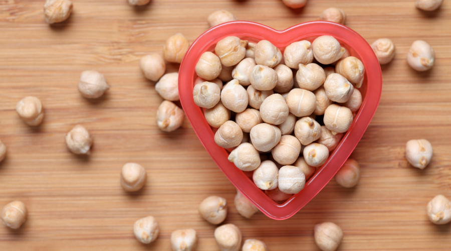 Chickpeas in a heart bowl. Close-up.